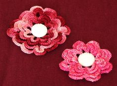 Set of 2 Handmade 3D Flowers -  One is in Shaded Garnets (upper left) and One is in Shaded Pinks (lower right) - both have a White Textured Button in the Center - There are Several Uses for 3D Crocheted Flowers like these: - As a Brooch or Pin - As a Pendant for a Choker or Necklace - As an Applique on anything Fabric from Clothing to Linens.  Put one or both of these 3D Flowers on Accessories such as Hats or Bags .... #Handmade  by   @rssdesignsfiber -- RSSDesignsInFiber