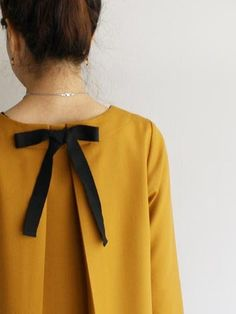 Love the mustard yellow and the bow.