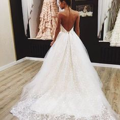 Low back wedding gown.
