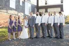 Entire bridal party in lavender dresses and gray suits