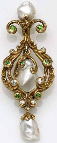 An antique pearl and demantoid garnet brooch,designed as an openwork scrolling frame accented with circular-cut demantoids, old European-cut diamonds, and baroque fresh water pearls; unsigned, attributed to Marcus & Co; mounted in eighteen karat gold. Via Bonhams.