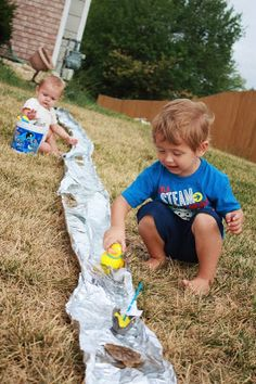 10 ft of tin foil, small toys and a garden hose. roll out the foil, fold up the sides of the foil, start the water
