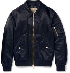 Ensuring a soft and cosy feel, this bomber jacket by British powerhouse Burberry is lined in a brushed wool-blend cloth patterned with the label's signature check. Cut from lustrous midnight-blue shell, it's finished with plush gold hardware and ribbed jersey trims that define the sporty shape. Multiple pockets offer plenty of space to stow personal effects, so you can gad about town hands-free.