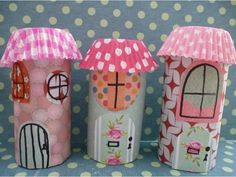 Super cute fairy houses made from toilet paper rolls and scraps of paper with pretty bun case rooves. A lovely craft for kids. Why not make a whole fairy village?