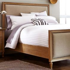 "<p>Elegantly wrapped with solid oak, this bed will be a traditional focal point in your bedroom for years to come.</p><div style=""page-break-after: always;""><span style=""display: none;"">"