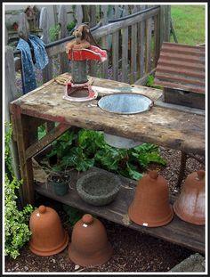 potting bench, old pump, Saltbox Farm Garden, Howard City, MI Garden Sheds, Garden Gates, Lawn And Garden, Garden Art, Garden Tools, Rustic Potting Benches, Potting Tables, Old Water Pumps, Old Bed Frames