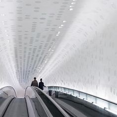 Curved escalators inside the Elbphilharmonie in Hamburg, designed by @herzogdemeuron. (Photo: @iwanbaan) #surfacemag #elbphilharmonie #hamburg #herzogdemeuron #architecturephotography