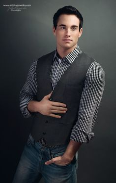 black gingham shirt, vest, jeans