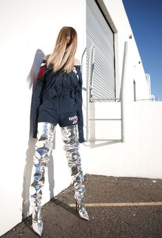 Get noticed this season with Balenciaga's statement sky-high metallic over-knees.