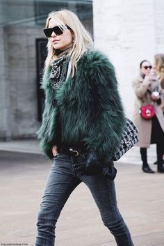 fuzzy green coat and skinny jeans