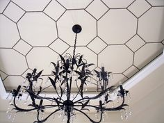 Using a cardboard template, a bunch of these nifty nailhead strips and a lot of patience, Pam created the gorgeous octagonal ceiling pattern in her dining room for about $65. I love the look of this; it's somehow subtle yet impossible to miss at the same time, and the geometric patterns set off the ornate chandelier marvelously.