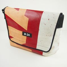 Condor - beige, red and white messenger bag from M-24 | Upcycled truck tarp bags made in the UK | Recycled truck tarp messengers