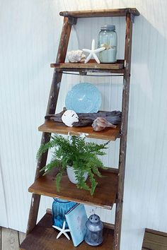 DIY Ladder Display Shelves - Instead of shelling out the big bucks, find an old ladder with charm and make one yourself! Home Beach, Beach Room, Beach House Decor, Beach Houses, Beach Cottages, Ladder Display, Display Shelves, Ladder Decor, Ladder Shelves