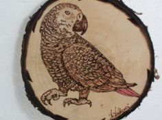 """This Aftican Grey is burned on an approximately 3 inch piece of birch.    The back is ready to be personalized with your choice of inscription....such as the pet's name or """"I love my African Grey"""""""