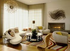 Flap sofa, Paul Smith rug, modern chandelier and wal sculpture...love