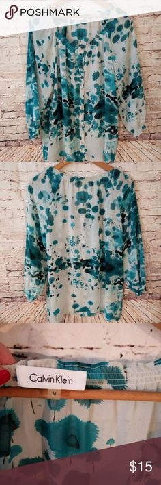 "Calvin Klein floral blouse, size med Calvin Klein floral blouse, size med Great condition Sheer fabric Buttons down front Armpit to armpit- 21"" Calvin Klein Tops Blouses"
