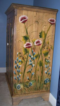 Love that it was painted with the natural wood still showing!...wine cabinet