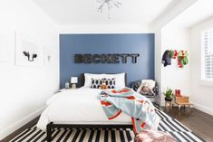 Bold, Contemporary Blue Boys Bedroom with Black and White Rug and Pops of Color by Amanda Barnes Interiors Little Boy Bedroom Ideas, Big Boy Bedrooms, Boys Bedroom Decor, Boys Bedroom Paint, Master Bedroom, Toddler Boy Room Decor, Toddler Rooms, Kids Rooms, Boy Rooms