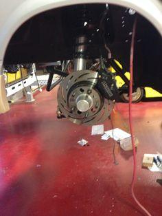"Front strange 4 piston brakes, strange coil overs, racecraft 2"" drop spindles"