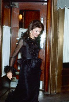 Jackie Kennedy Onassis walking out of La Côte Basque, 1970