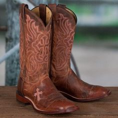 Go western with Tony Lama! These fun cross Inlay Western Boots are great for the modern cowgirl! Mixing vintage western style with modern detailing, these boots feature a embroidered cross highlighted