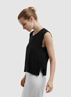 SIDE NOTE: THIS IS A FAN FAVOURITE. Sleek stretch silk panels create a beautiful drape and add multidimensional appeal to this sleeveless staple. Tuck in the front to a contour-fitting skirt or wear it over a dress, the options for layering are endless.