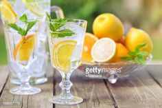 Stock Photo : Refreshing water with ice and citrus fruit slices