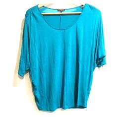 Women's off the shoulder teal shirt. XS. Off the shoulder, teal, quarter length women's short. Loose fitting and so comfortable to wear. Pair with leggings or a great pair of jeans, and a long necklace! Express Tops