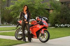 """Megan Fox reprised her role in """"Transformers: Revenge of the Fallen"""" as she appeared in a black leather outfit on a red motorcycle in this promotional shot from the film."""