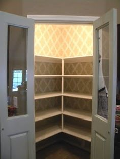 wallpaper in pantry - makes pantry look so awesome! I want this corner pantry!!!