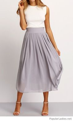 A white top, grey midi skirt with sandals
