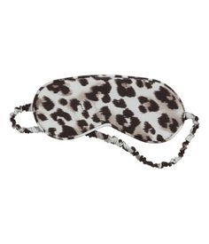 Light gray/black. Sleep mask in soft, leopard-print woven fabric with covered elastic at back and polyester padding.