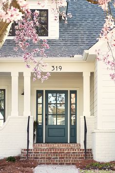 Front door is Yorktowne Green & exterior paint is White Dove both by Benjamin Moore exterior Small Modern Farmhouse with Front Porch Farmhouse Front, House Front Door, Exterior House Colors, Exterior Paint Colors For House, House Paint Exterior, Paint Colors For Home, Green Front Doors, Exterior Brick, Exterior Doors
