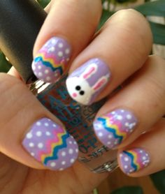 Easter egg nails with a bunny accent nail:   This is on my to-do list for today.  (doing my daughter's Easter nails!)