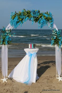 we love this round arch too, most bride are going with the bamboo arch but this little round are makes a big statement too   www.beachbrideguides.com Beach Wedding Centerpieces, Wedding Decorations, Round Arch, Clays, Buttercream Frosting, Our Love, Beaches, Our Wedding, Bamboo