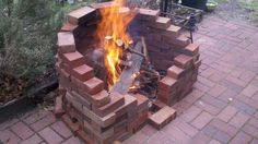 Made by a DIYer with old bricks. I want a firepit in our back yard, and this is totally inspiring me!!