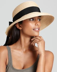 267d8b54 Top off your vacation-ready look with Helen Kaminski's packable sun hat,  accented with