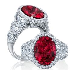 A prime example of an exquisite ruby and diamond piece of jewelry: this pure platinum ring by JB Star has a 5.90 ct. oval-shape ruby at the center, enveloped by micro-pave white diamonds, with a step-like arrangement of three halfmoon diamonds on each side, also edged in micro-pave. And let's not forget the beautifully carved head, with even more pave diamonds. What a ring! www.diamonds.pro