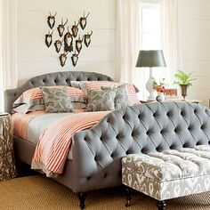 In a large master bedroom, choose a fully upholstered headboard and footboard to anchor the room. | SouthernLiving.com