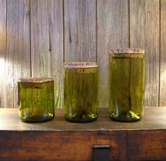 I LOVE these upcycled wine bottle canisters!
