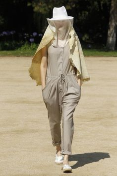 Latex textured cape. Long cotton overall.