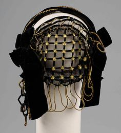 Evening headdress Date: ca. 1855 Culture: American Medium: Silk, metal, beads Credit Line: Brooklyn Museum Costume Collection at The Metropolitan Museum of Art, Gift of the Brooklyn Museum, 2009; Gift of Mrs. Robert G. Olmsted and Constable MacCracken, 1969