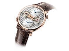 "Arnold & Son - DTE - features a ""Double Tourbillon Escapement"" and dual time."