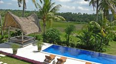 Villa Ahn - This spacious 3-bedroom, 2-level villa is situated amongst emerald green rice fields, and offers manicured lawns, a glittering blue swimming pool. #bali #ubud #luxuryvillas #villas #ricefields #ultimatebali