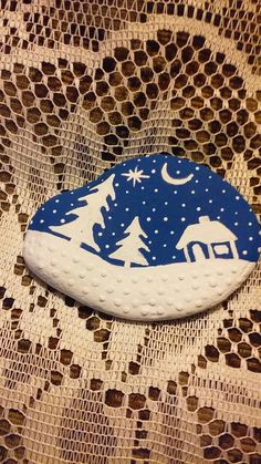 House, 1 of 4 winter themed scenes painted on a Lake Huron beach stone by Cindy P 2017