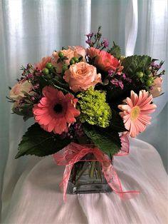 Gerbera daisy, rose, hydrangea, waxflower, hypericum berries