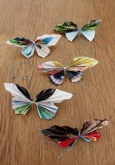 Butterfly craft: cut out butterfly shape in a magazine page, fold accordion-style from bottom, tie in the middle with yarn