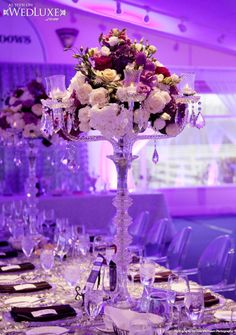 Floral Design: candelabra and flower centerpieces. High design for wedding reception, so elegant and classy! Love this beautiful tall look! Flowers, centerpiece, wedding, reception.