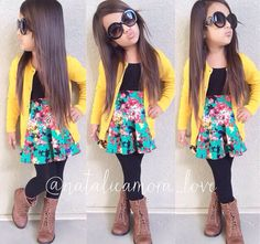 (black tank. yellow cardi. floral skirt. black leggings. boots)