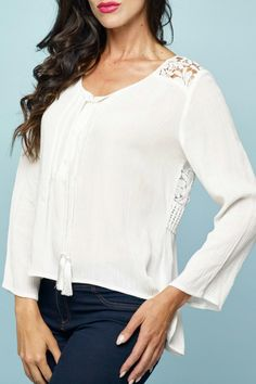 Cream flowing top lace detail. Comes with separate cream tank top. It features a V opening with lace in the back.   White Lace Top by Minkas. Clothing - Tops - Long Sleeve Canada